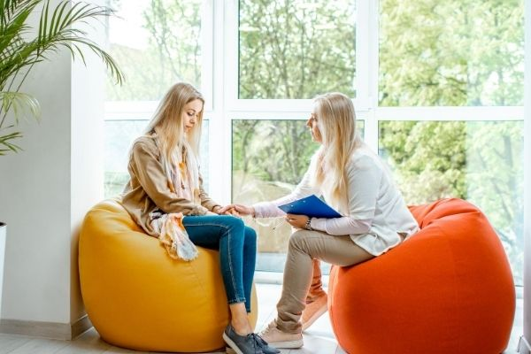 two women sitting in front each other doing individual christian counseling services