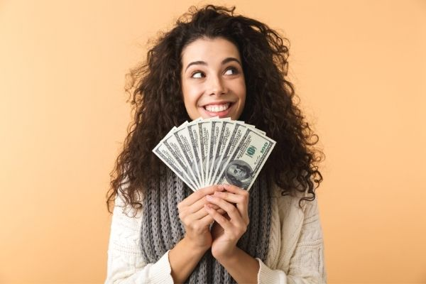 woman holding dollars for finances